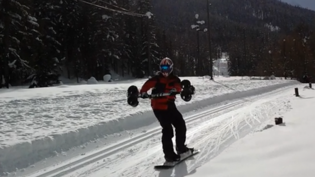 Snowboarder Glides With Handheld Airplane Thrusters