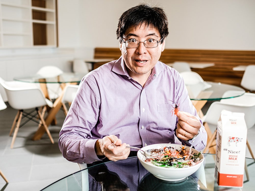 Sam Wang with bowl full of insects
