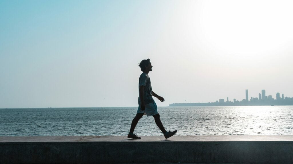 a person walking along the waterfront