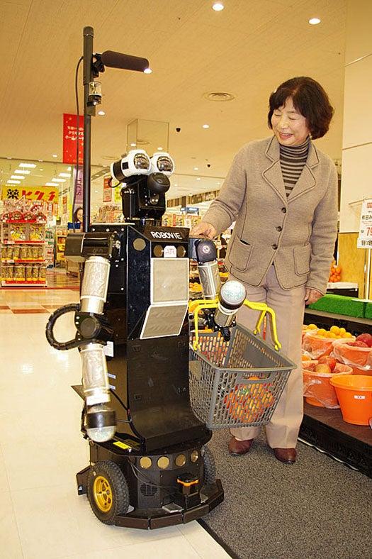 Robovie-II, the Robot That Helps You Buy Groceries