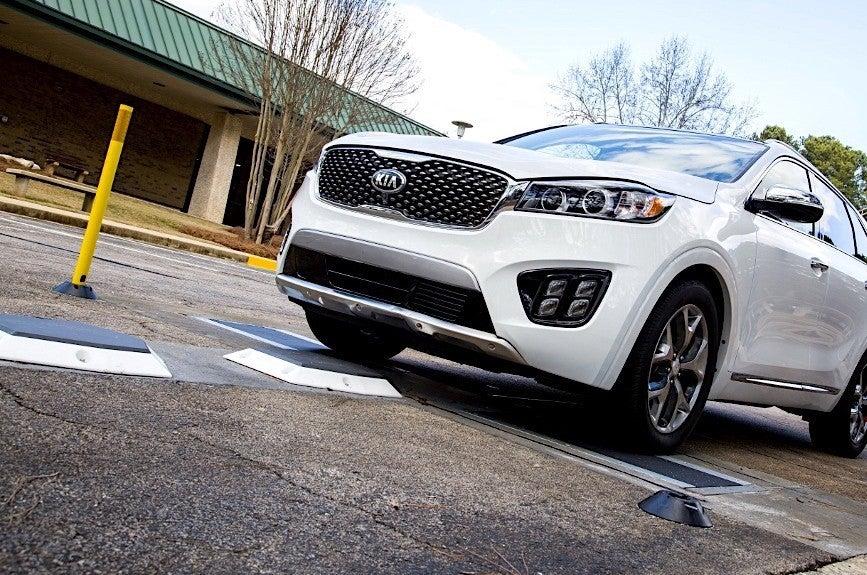 a car rolls over sensors on the road