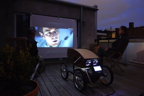 projector on sheet on side of house