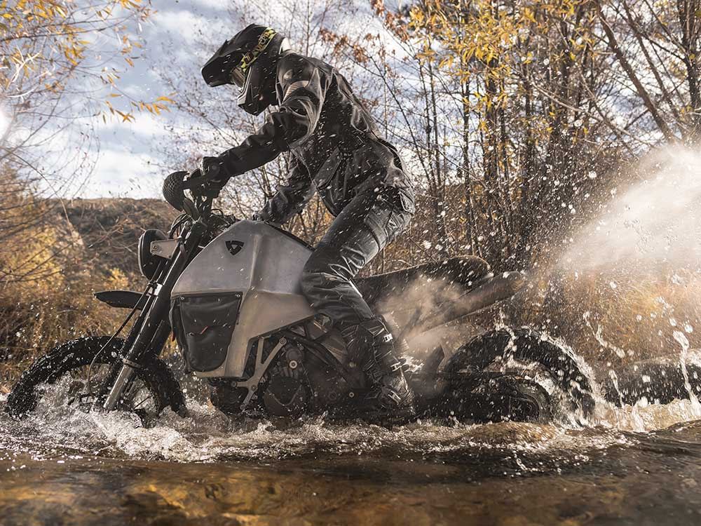 crossing a stream on a motorcycle