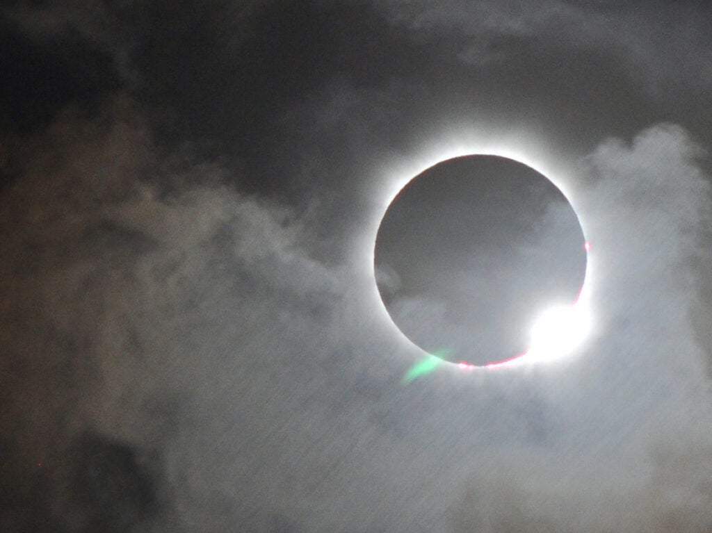 total solar eclipse through clouds