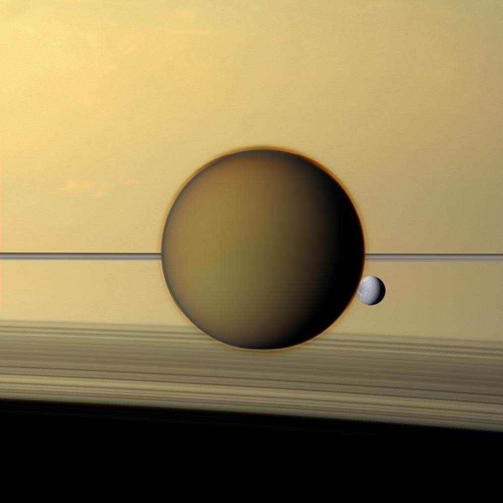 titan and dione in front of saturn