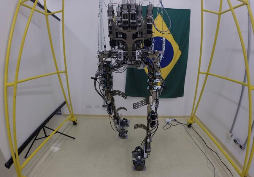 Human In Robotic Exoskeleton To Kick Off The World Cup