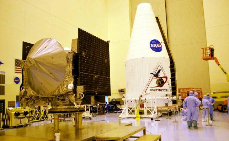 The OSIRIS-REx spacecraft and its Atlas V rocket fairing inside NASA's Payload Hazardous Servicing Facility