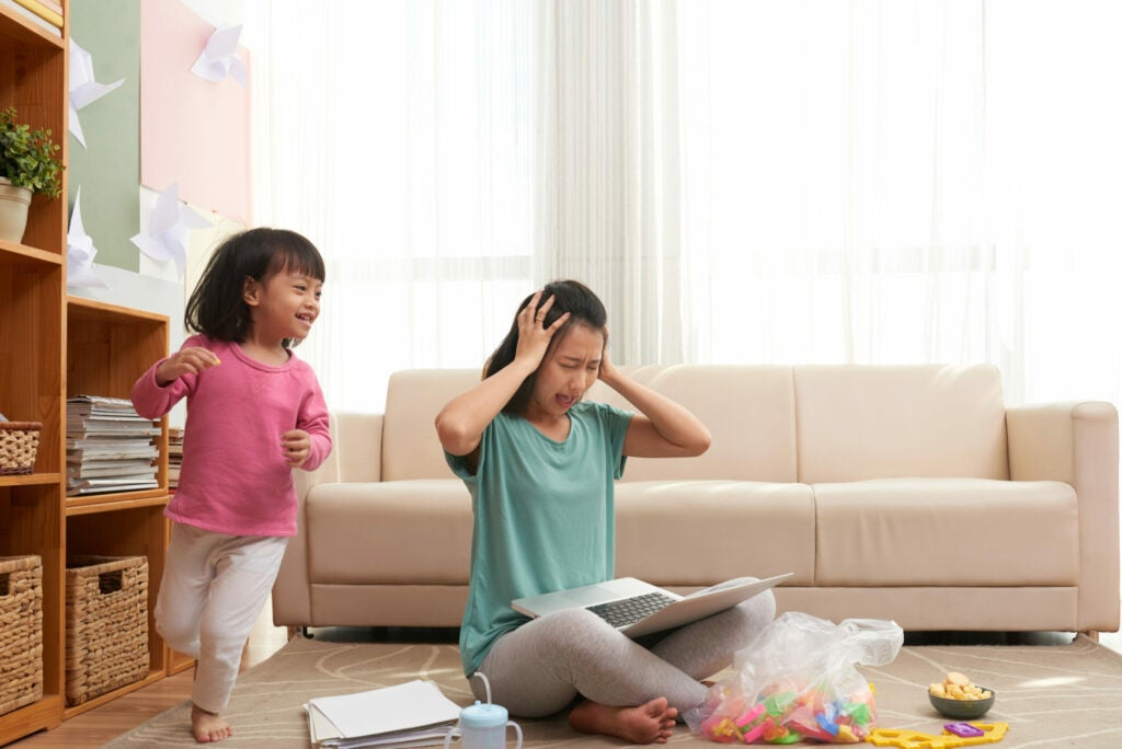 stressed mother and running child