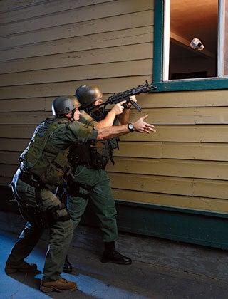 LASD deputies toss a video camera through a window