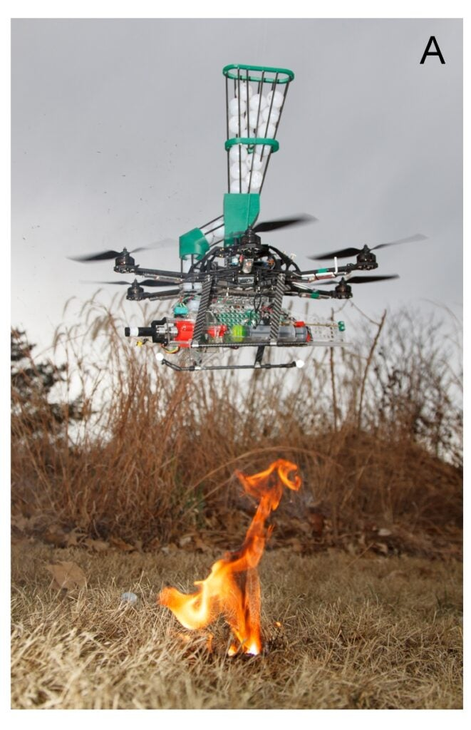 Fire starting drone prototype starting a fire in a field.