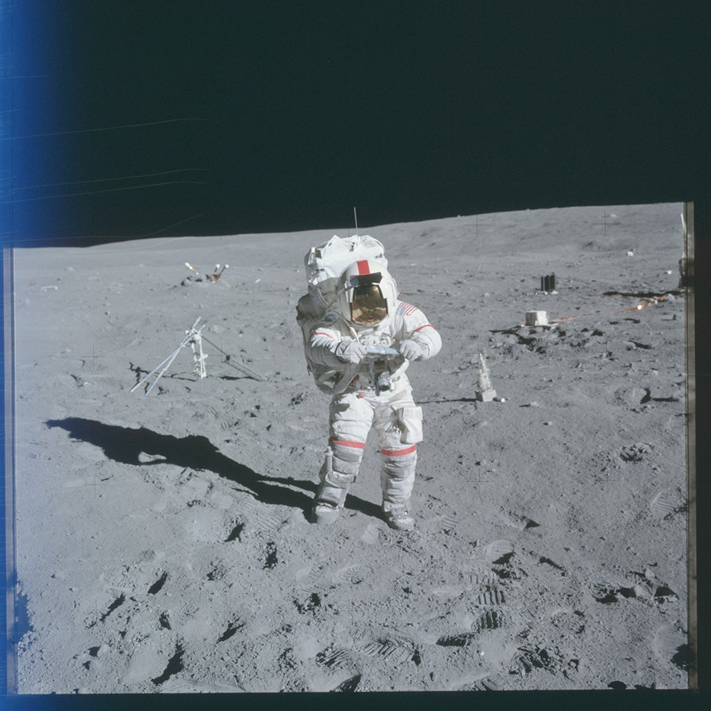 astronaut on moon with Hasselblad camera