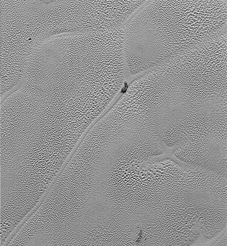 New Horizons Sees A Slice Of Pluto's Heart, Dirty Water Icebergs, and More