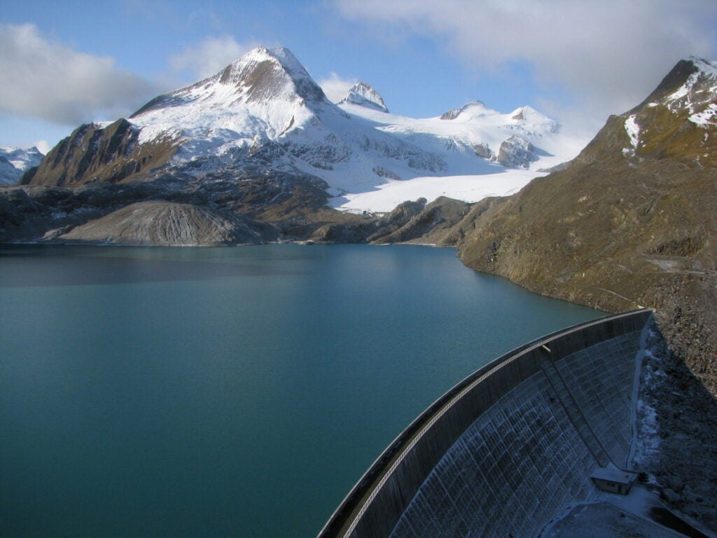 A dam collects water supplied by the Gries glacier.