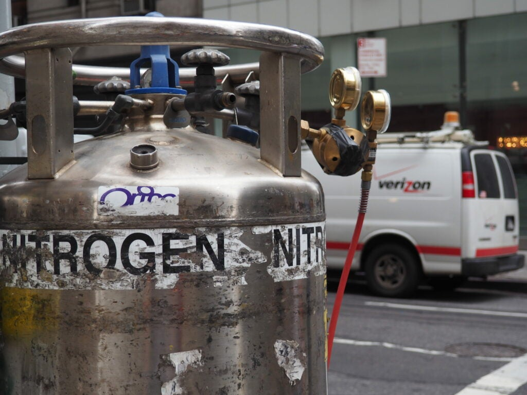 nitrogen canisters in front of a Verizon van