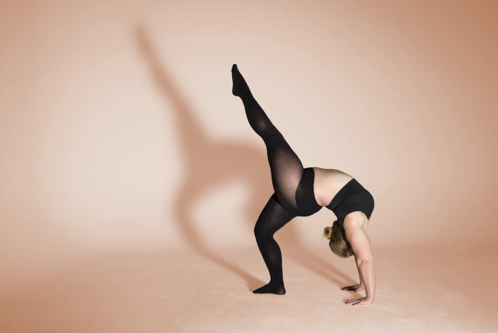 A woman doing yoga in tights