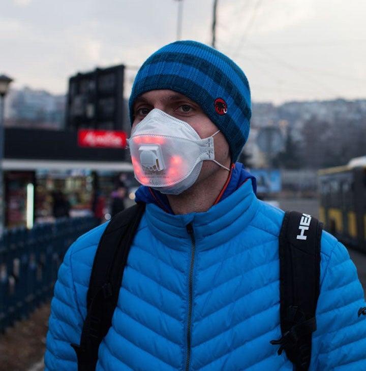 Man wears Airbeam LED mask