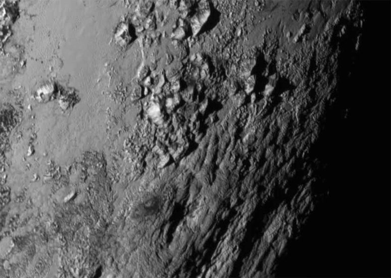 Pluto's surface is covered by young, icy mountains