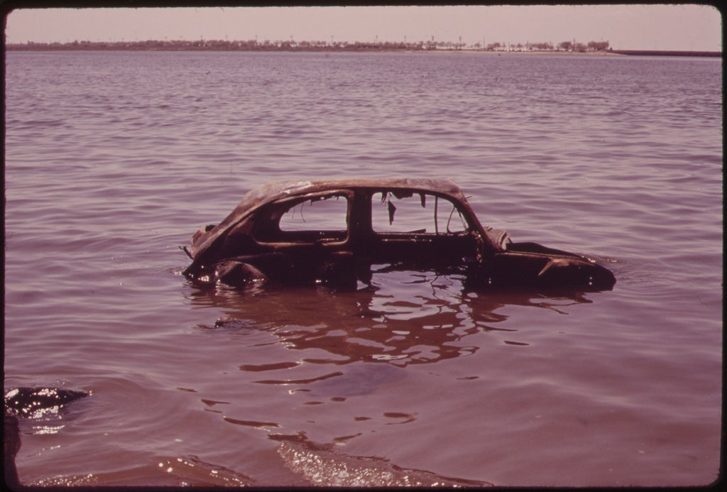 abandoned car in bay