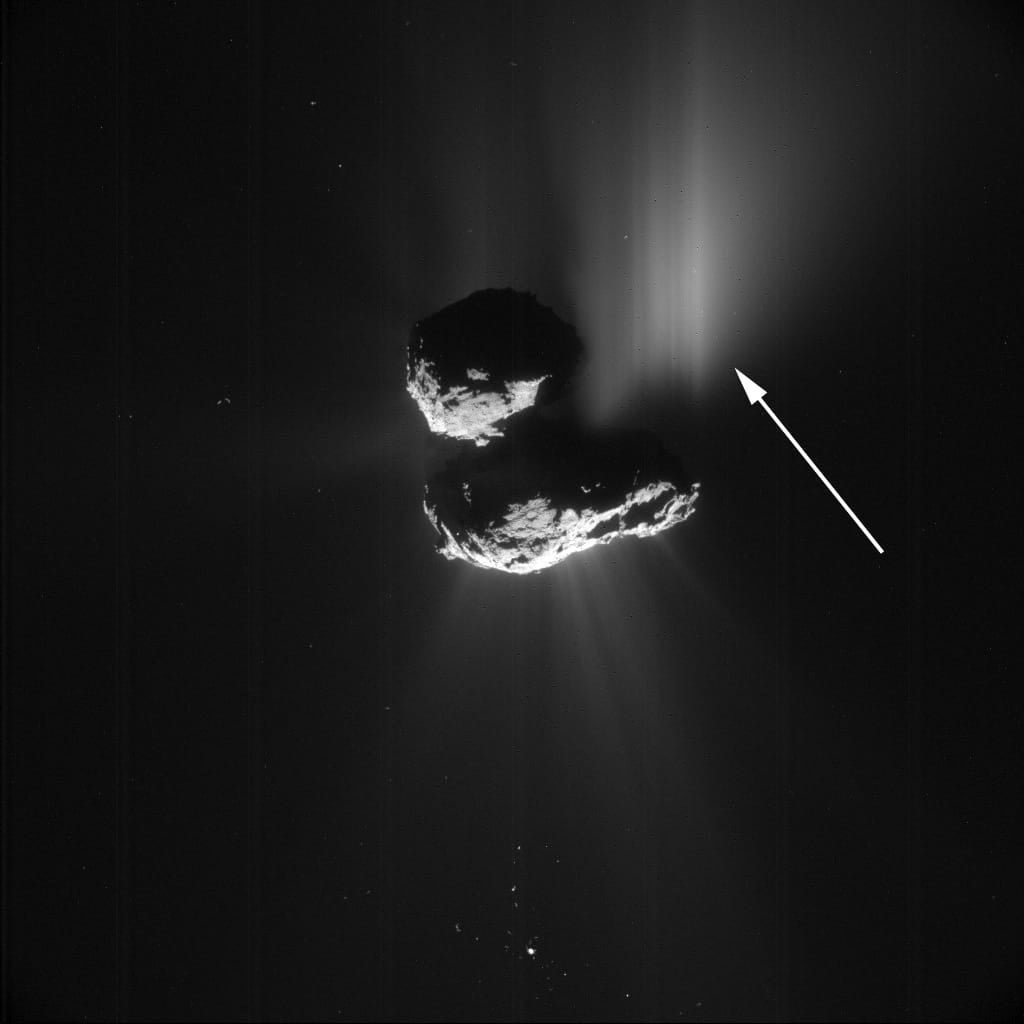A giant cliff collapse on a comet reveals pristine ice beneath the surface