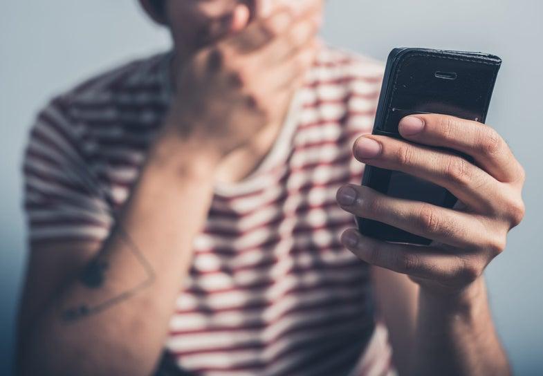 a man reading a phone
