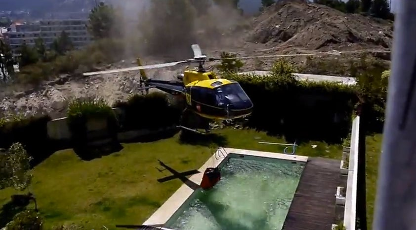 Video: Firefighting Helicopter Grabs Water From A Pool
