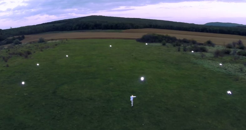 Watch A Man In A Light-Up Suit Dance With Drones [Video]