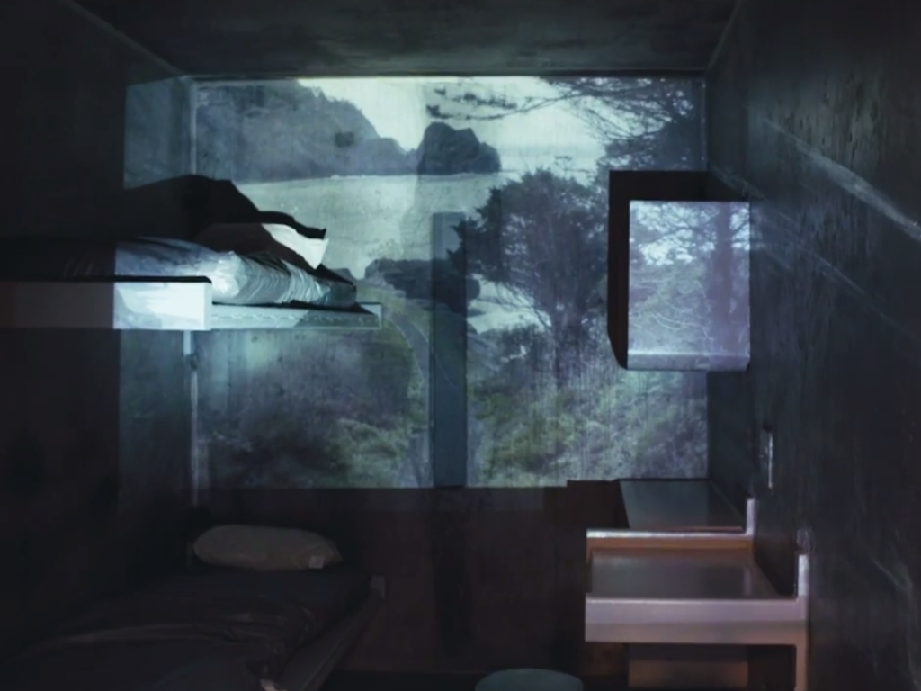 Prison cell at Pelican Bay State Prison with projected nature scene on the wall.