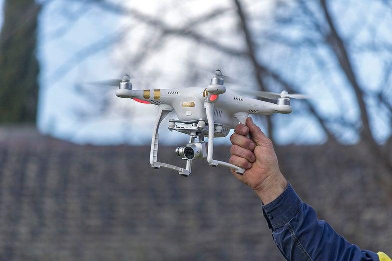 a man holding the DJI Phantom 3 Professional drone