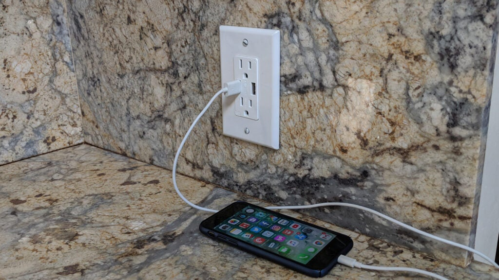 new USB outlet charging a smartphone