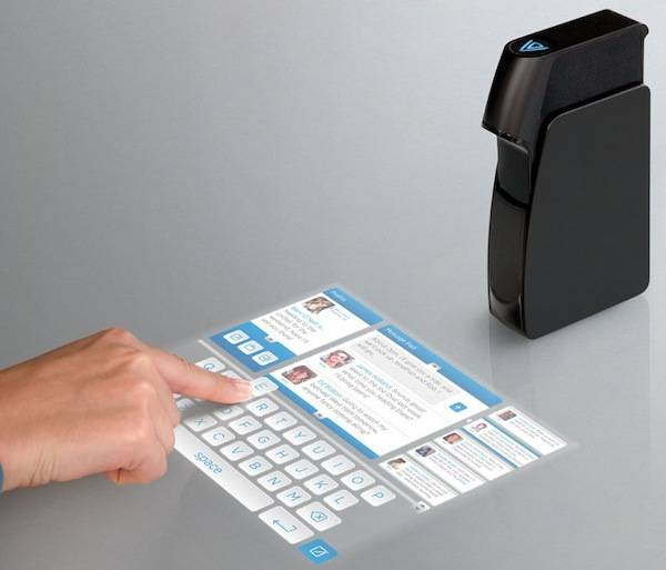 A Mobile Touchscreen Projectable On Any Flat Surface