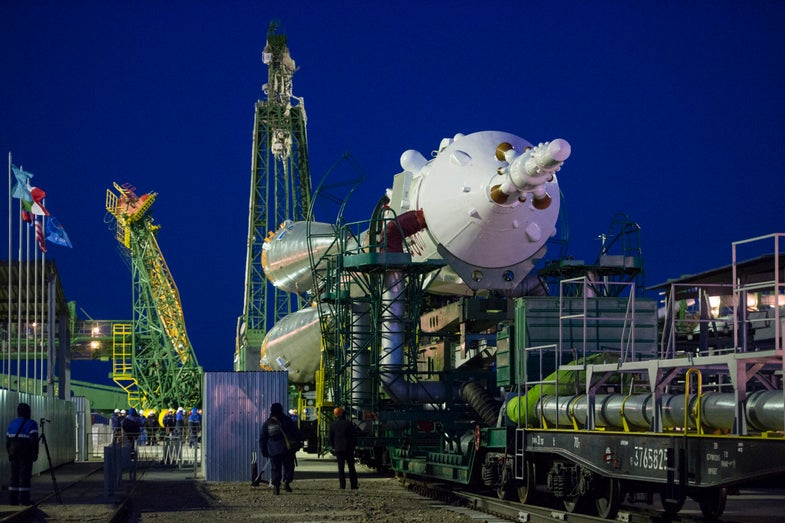 Soyuz rocket is wheeled to launchpad