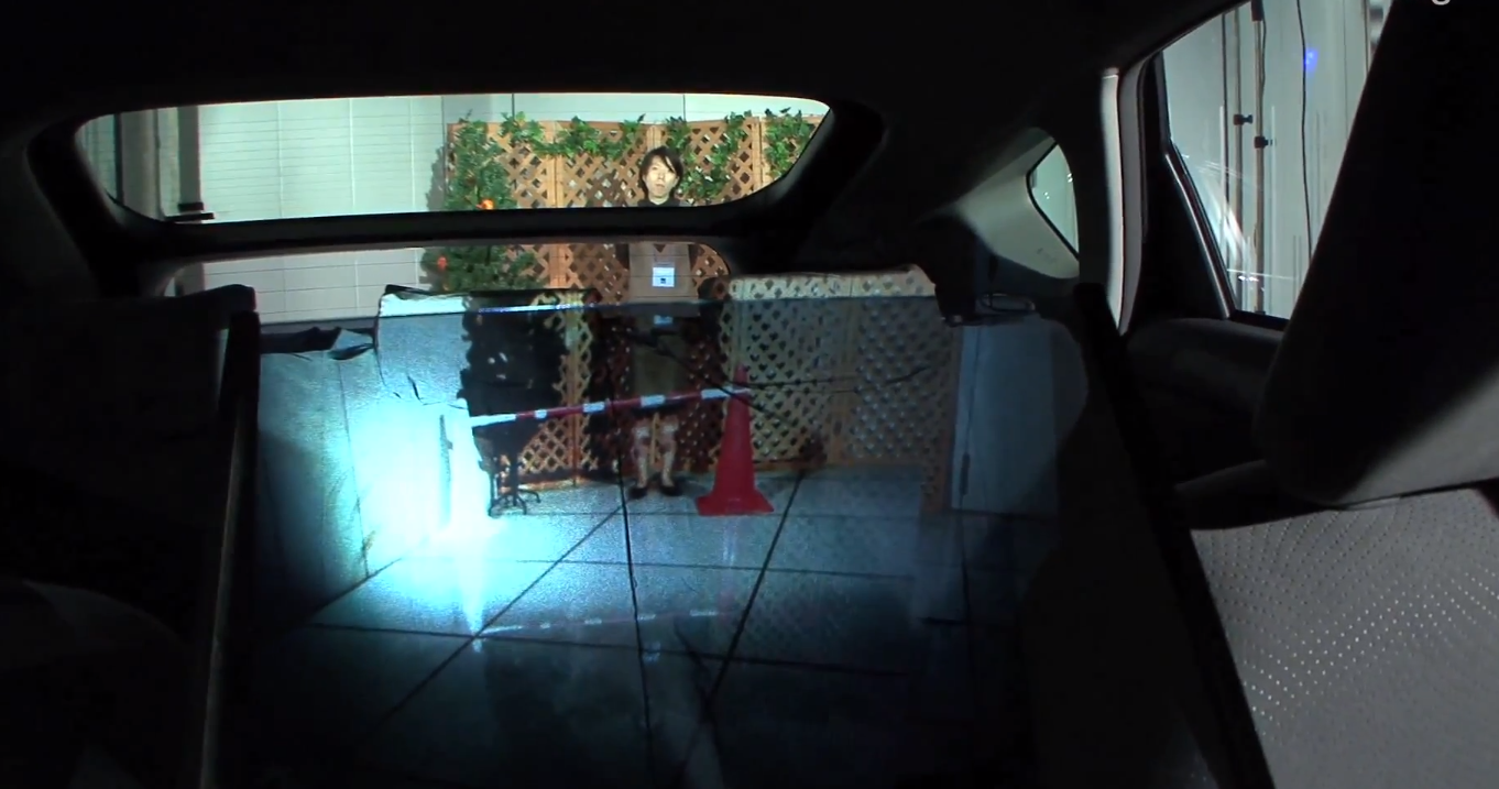 Optical Camouflage Renders The Backseat Of A Car Transparent