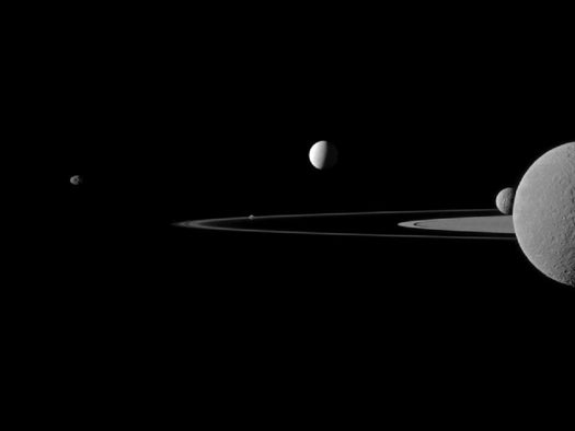 Five of Saturn's Moons Pose Amidst a Backdrop of Planetary Rings