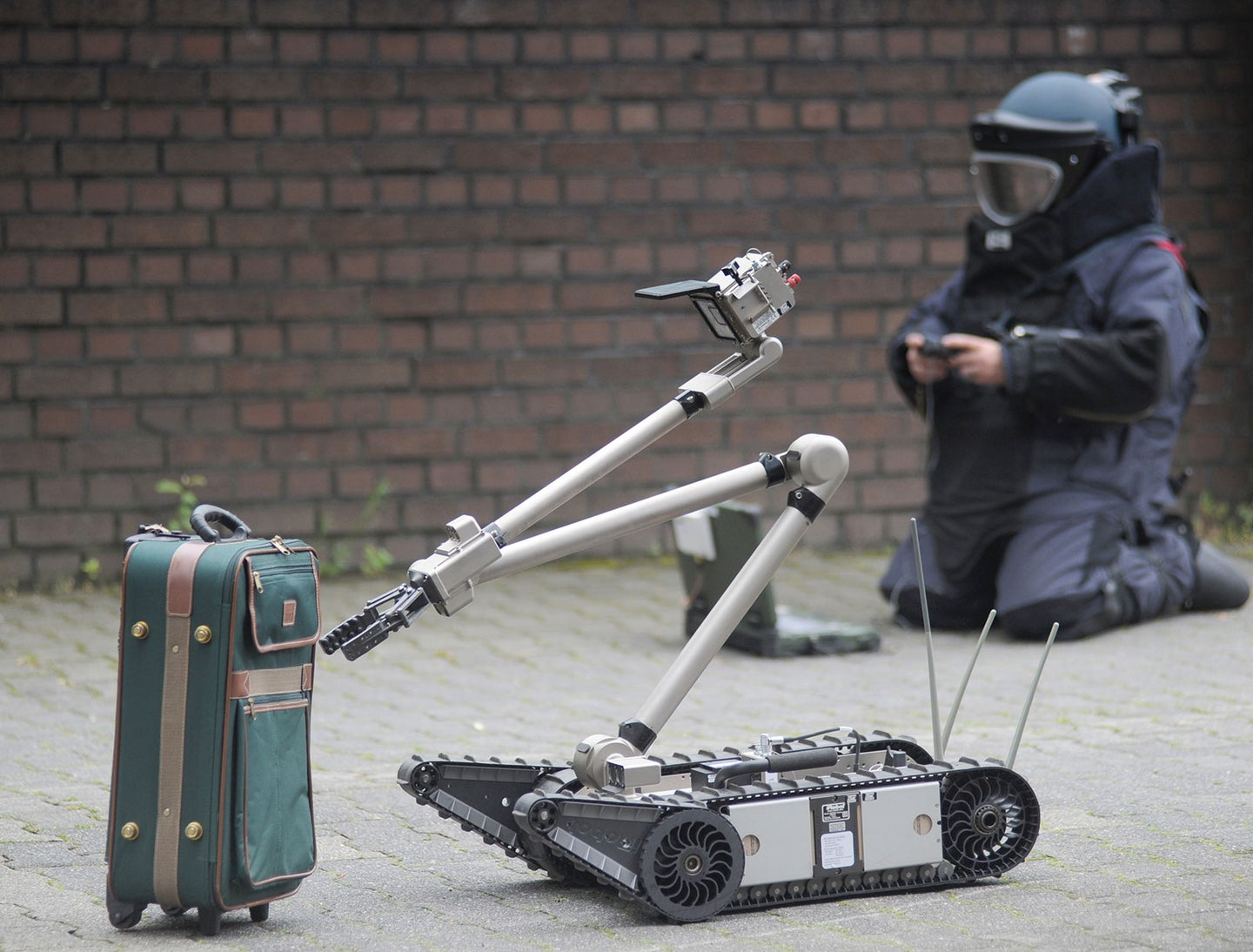 Robot Inspects Suitcase