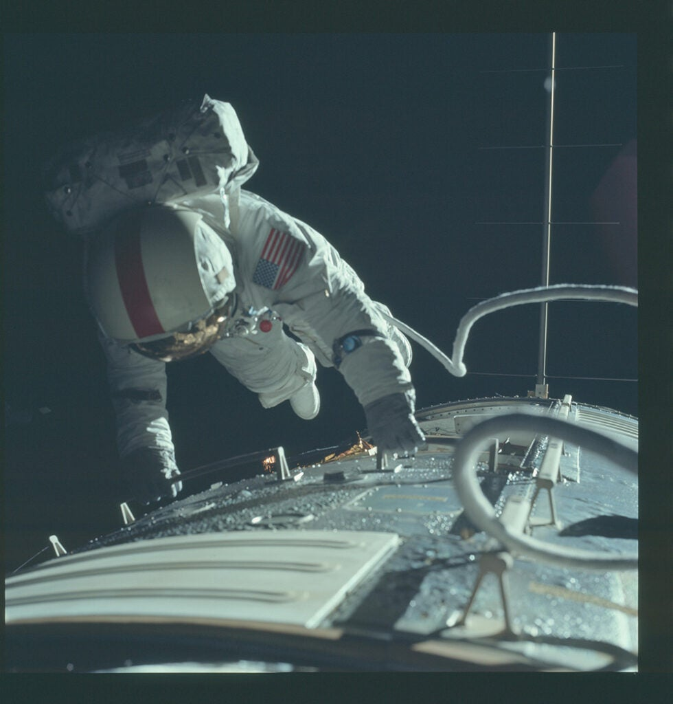 astronaut fixing ship