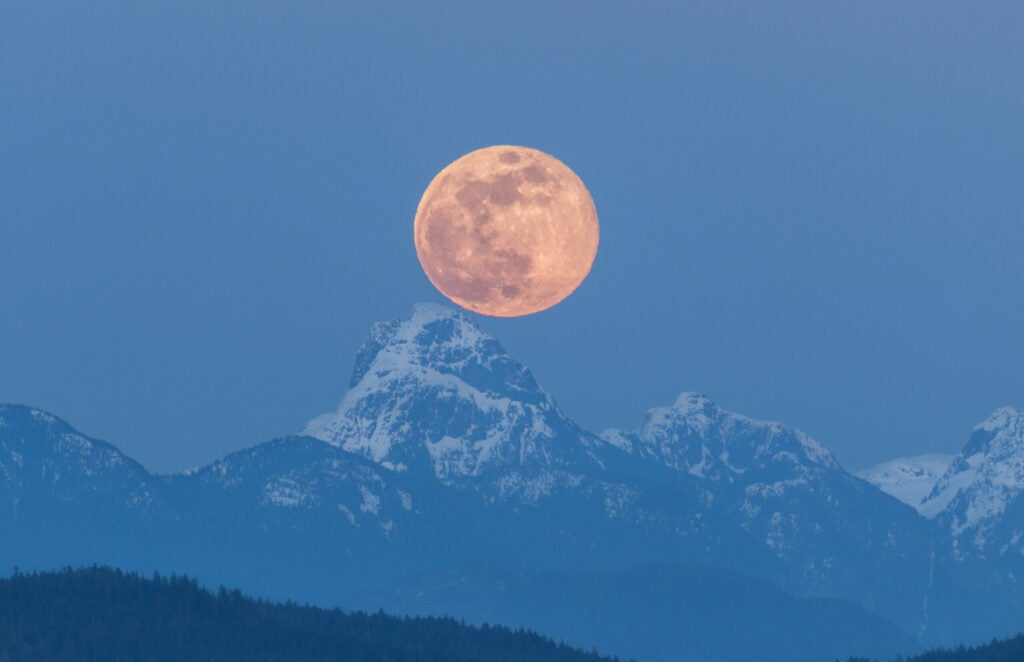 supermoon over mountain