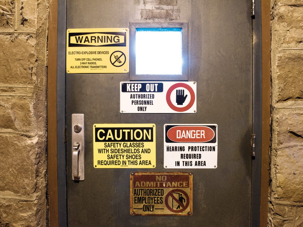 EBAD test lab door with warning stickers