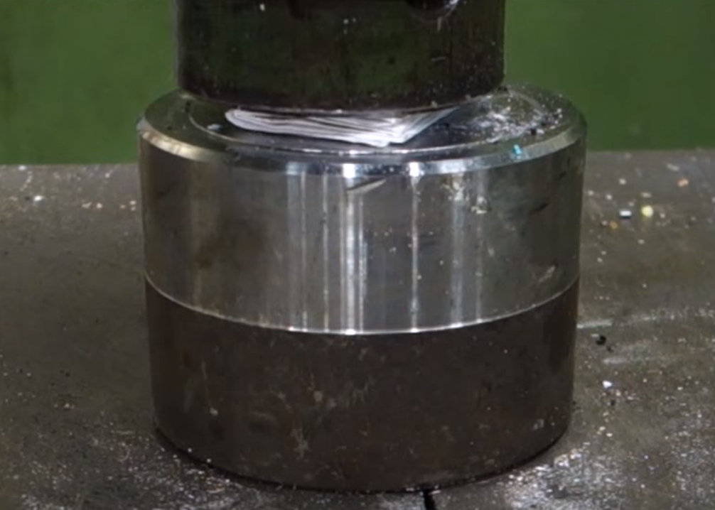 Why This Piece Of Paper 'Exploded' In A Hydraulic Press