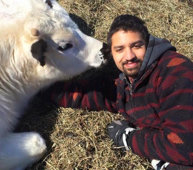 farmer Logan Davis with one of his farm animals