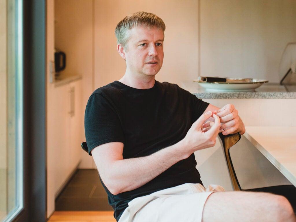 Jaan Tallinn sitting at desk