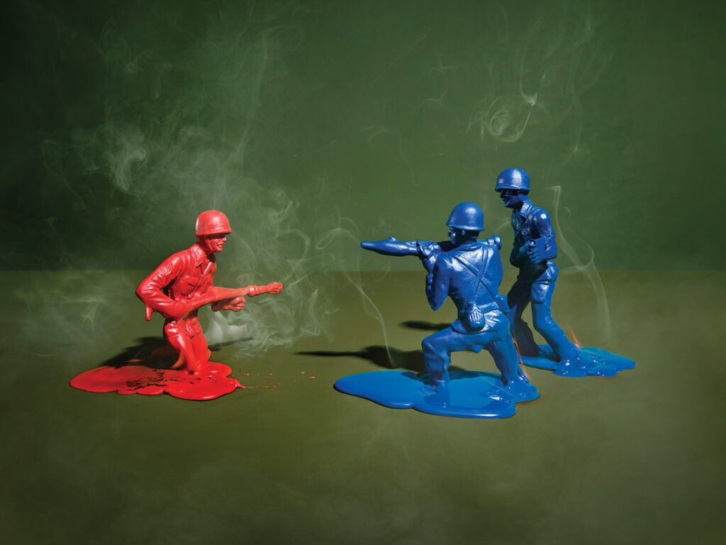 two blue and one red army man melting into floor