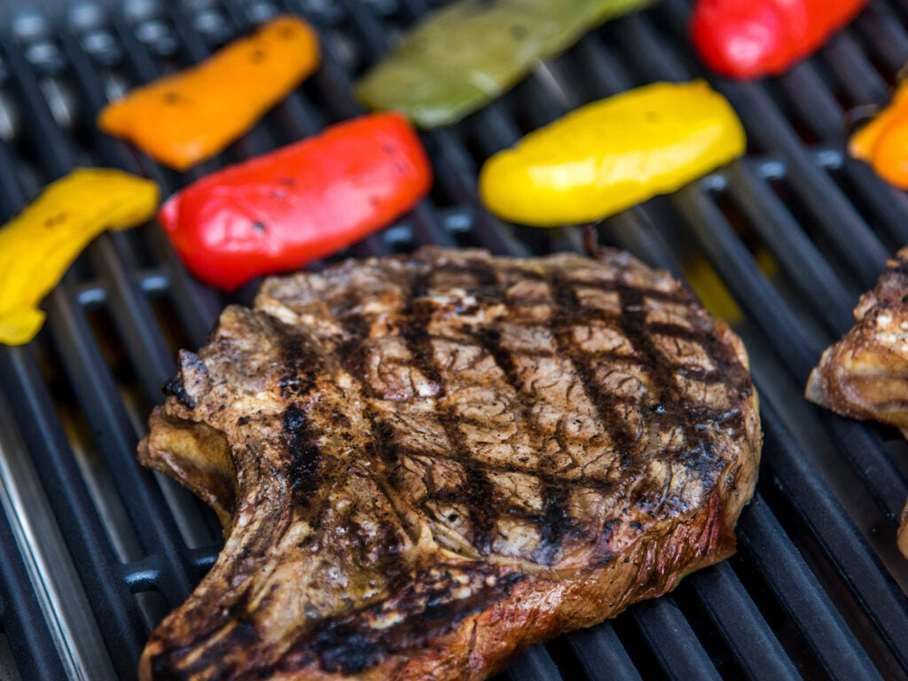steak and peppers on the grill