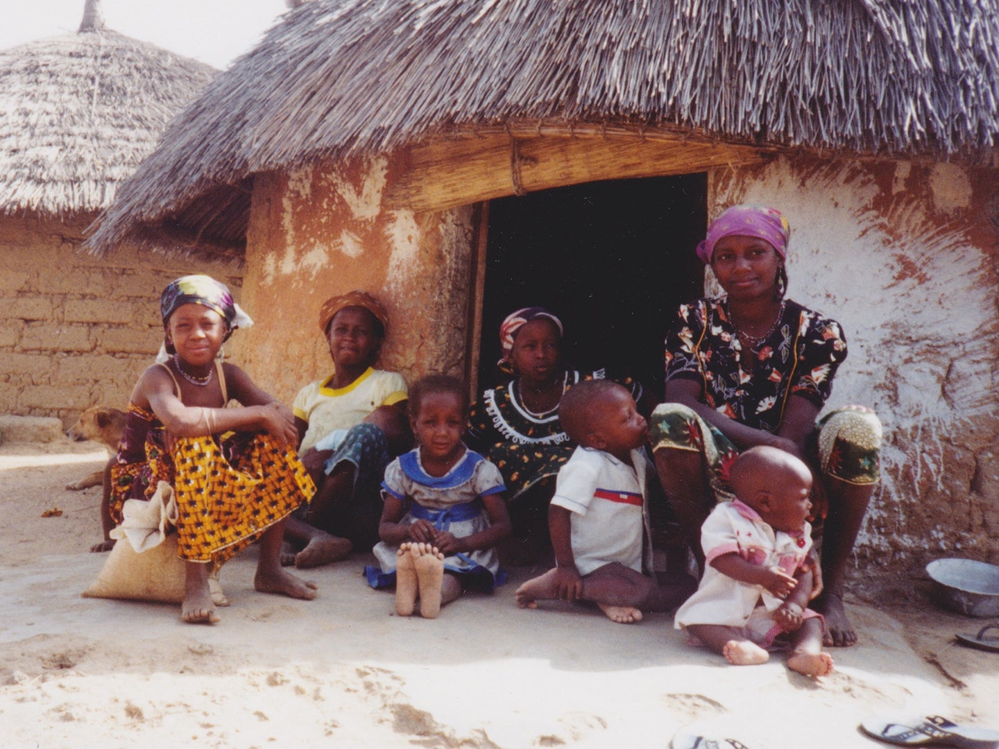 A mother and her children outside their home in rural Nigeria