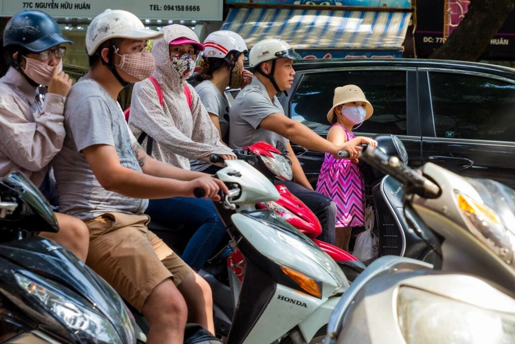 Commuters wear masks to protect themselves from air pollution