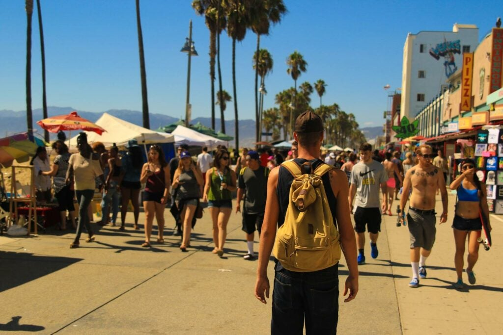 People walking along Venice Beach in Los Angeles
