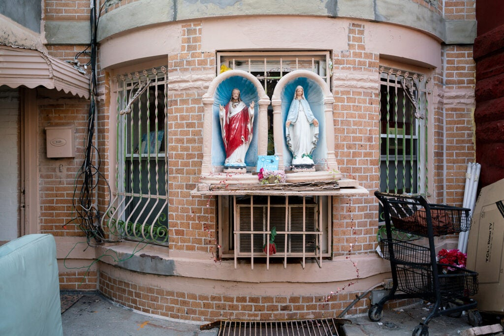Religious figures outside of an apartment building