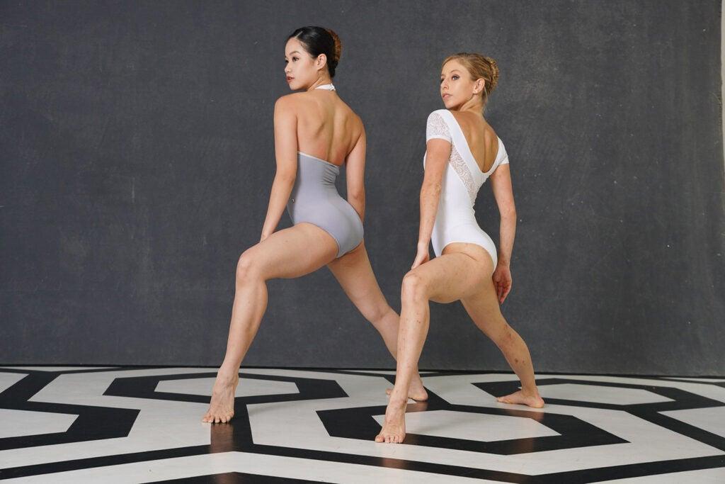 dancers on black and white geometrical floor