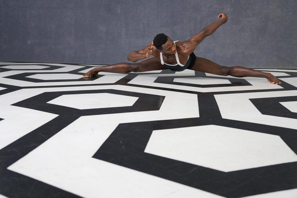 dancer on black and white geometrical floor