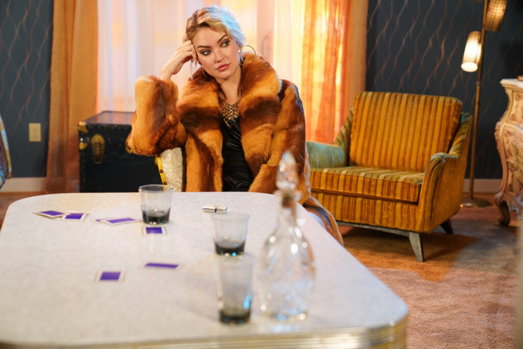 woman in fur coat at the table