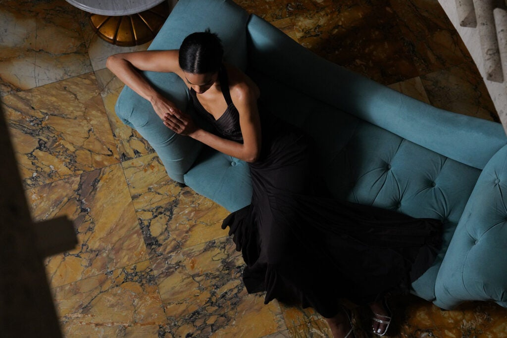 woman lounging on couch